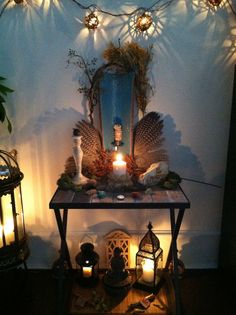The lighting, reflections and shadows around this sweet little table top altar make it magical. (And those wings!)