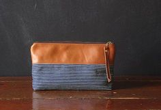 leather + stripe denim/ clutch/make up bag