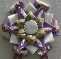 View our collection of ribbons and rosettes available in accents including floral, patterned, glittery golds, silvers and more. Ribbon Rosettes, Ribbons, Football Mums, Centaur, Eggshell, Homecoming, Orchids, Photo Galleries, Gift Wrapping