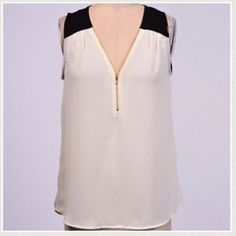 Ivory Sleeveless Top Ivory chiffon style top with black shoulder trim. Zipper on the front. Only large left. Price is firm. ❌No Trades/PP❌ Tops