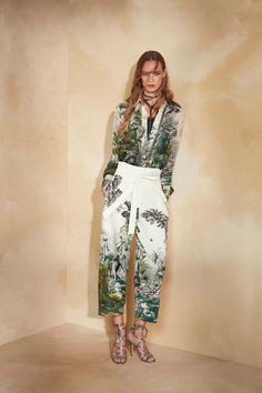 Landscape printed on fabric turns up at Alberta Ferrettis resort collection. Here as a co ord set. Shirt and high waisted culottes, waist clear in white and the legs decorated with nature print, the shirt is sheer with nature print all over except the buttoned down that is clear white. By Alberta Ferretti, spring 2018 Resort.