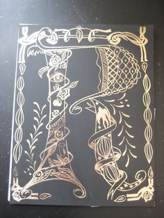 Illuminated letters on black and gold scratchboard, Anoka Middle School for the Arts