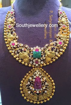 22 carat gold antique finish elaborate peacock design necklace featuring peacock design pendant and adorned with floral motifs studded with polki diamonds and rubies. It has a carved emerald at its center and carved ruby Ganesh at the center of pendant. For price inquiries contact:Psatyanarayanandsons@gmail.com Phone: +917680944450 Related PostsPeacock Mango Pacchi Haram and JhumkasAntique Peacock
