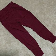 Burgundy Flowy high waisted pants So cute and perfect with a crop top!! These pants will slim your waist, I've gotten many compliments while wearing them. Has half elastic at the waist and also at the ankle. Perfect for spring Forever 21 Pants Ankle & Cropped