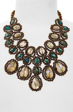 Make every outfit dramatic with a gorgeous crystal bib necklace.