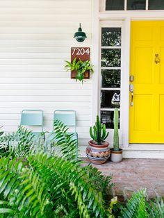 yellow front door and cacti