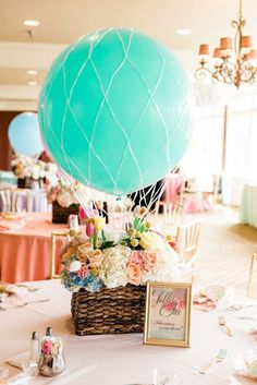 Hot air balloon themed baby shower with hot air balloon floral centerpieces and watercolor table numbers in gold frames Baby Girl Shower Themes, Girl Baby Shower Decorations, Baby Boy Shower, Baby Showers, Table Decorations, Hot Air Balloon Centerpieces, Baby Shower Centerpieces, Floral Centerpieces, Big Balloons