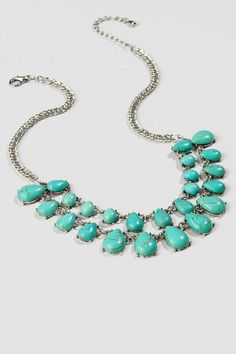 """Enhance your natural beauty with the Roswell Statement Necklace. The double strand of turquoise teardrops features stones of various sizes on a silver chain. Add this necklace to a simple top and boots for aclassic boho look.<br />  <br />  - Finished with a lobster claw clasp<br />  - 18"""" length<br />  - 3"""" extension<br />  - Lead & nickel free<br />  - Imported"""