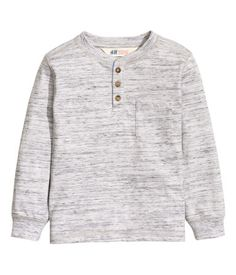 Long-sleeved henley shirt in striped cotton jersey with a washed look. Button placket, chest pocket, and ribbing at neckline and cuffs.