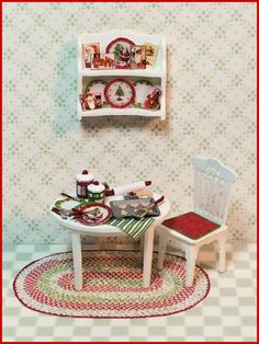 "1/4"" Merry & Bright Part Trois This 1/4"" scale kit coordinates with our original holiday vignette kit, the part deux kit and the spice tin room box kit. INCLUDES: the table, a chair, the wall shelf, utensils, all of the accessories and the rug. Finished Sizes: Table approx 1"" w x 3/4"" d x 5/8"" h. Chair approx 1/2"" w x 1"" h. Wall shelf approx 3/4"" w x 3/16"" d x 5/8"" h."