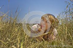 Young woman dreaming in the field