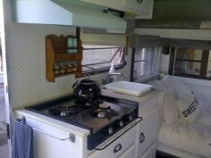 my camping trailer after a coat of white paint!