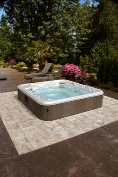 Build your patio around your hot tub and utilize stamped concrete and tile