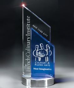 The Glass Peak Duet Award is a fusion of clear and blue optical glass, deep etched with your custom engraving and logo.  The award is elevated on a handsome brushed silver base.  T