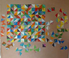 I'm getting some fantastic quilt inspiration from this shot of Cathy Underhill's (of Cabbage Quilts) design wall. I would love to design a quilt top that looked just like an explosion like this with blocks cascading away from a center mass.