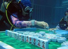 Fancy diving and mahjong at same time? No problem