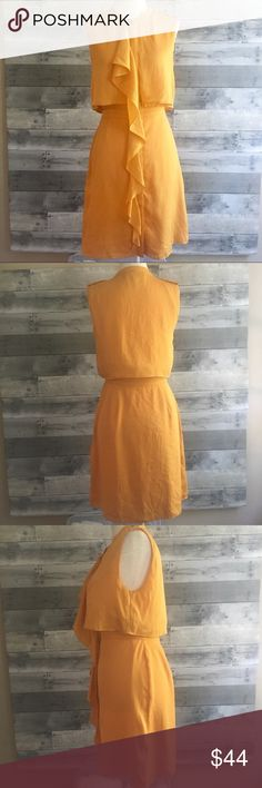 """Sachin & Babi Silk Ruffle Dress Yellow Orange Sachin + Babi silk sleeveless dress in a mango yellow-orange color. Buttons down front, epaulettes at shoulders, ruffle detail.  Size 2 - fits like an XS. Approximate measurements: armpit to armpit 17"""", waist 13"""" across, hips 19"""" across.  GUC. Minor wear. No major stains, holes, or snags. The last three pictures show a pin hole near neckline, a small stain on ruffle, and an abrasion near bottom hem. None of these are very noticeable when wearing…"""