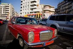 A good old red #Mercedes infront of Mac donnalds and Hard Rock Cafe. #Beirut #Cornice