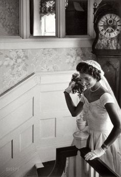 "September 12, 1953. Newport, Rhode Island. ""Kennedy wedding -- Jacqueline Kennedy throwing the bouquet."" Gelatin Silver print by Toni Frissell."