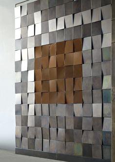De Castelli 3D wall tile system shown in corten and acid etched iron.  We would love to install these in our showroom!