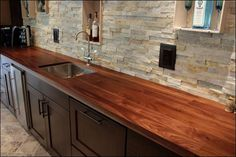 Kitchen, Elegant Butcher Block Countertop Looks Matching With Natural Stones Backsplash Also Dark Brown Cabinet: Kitchen Countertop as the M...
