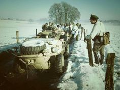 Several VW Type 166 Schwimmwagens in winter conditions operating with a SS Division