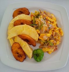 Ackee and Saltfish served with fried plantains and breadfruit