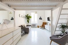 A small, 29 m2 split level studio apartment in Budapest with bright interiors, scandi style. The paintings on the walls are the owners DIY artwork.