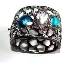 Bracelet: Titanium, Silver, Quartz and pink sapphires.