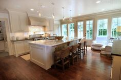 In a home with an open floor plan, the kitchen island often serves as a bar/table