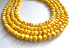 The Kuta- Yellow and White Wood Statement Necklace on Etsy, $78.00