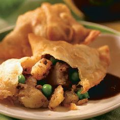 These fried, triangular turnovers, so popular at Indian restaurants, make great finger food for parties. Serve with Cilantro Dip and Sweet & Sour Dipping Sauce. Garam Masala, Samosas, Bangladeshi Food, Party Finger Foods, Peanut Oil, How To Cook Potatoes, Plain Yogurt, Coriander Seeds, Fresh Lemon Juice