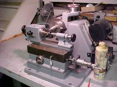 Benchtop milling machine.  RJS horizontal mill fitted with a WW lathe bed for use with Levin headstock and dividing plates.  It has both a lever and screw feed for cutting either wheels or pinions.