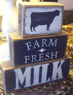 3 - Piece primitive shelf sitter. Painted in Dark Night Blue with Light Ivory Lettering. Farm Fresh is stenciled, where as the cow silhouette