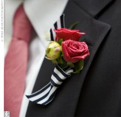 Boutonniere with blue & white strip ribbon. Forget the pink... white flowers only.