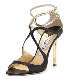 """Jimmy Choo napa and mirrored leather sandal. Golden hardware. 4"""" lacquered heel. Curvy vamp straps. Double-adjustable ankle straps. Lightly padded footbed. Smooth outsole. """"Lang"""" is made in Italy."""
