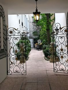 Beautiful gates in Paris, open up to a darling courtyard. Outdoor Rooms, Outdoor Living, Garden Design, House Design, Wrought Iron Gates, Belle Villa, Paris Apartments, Entrance Gates, Garden Gates