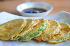 Korean Zucchini Fritters (Hobak Jeon) is a great banchan(side dish) for your everyday meal. It is the simplest way to enjoy the sweetness of zucchinis. Pan Fried Zucchini, Fried Zucchini Recipes, Savoury Recipes, Vegetable Recipes, Squash Fritters, Zucchini Fritters, Korean Side Dishes, Main Dishes, Recipes