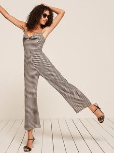 For vacation or just feeling like you're on vacation. This is a wide leg jumpsuit with a center front tie, pockets, and a smocked back bodice.