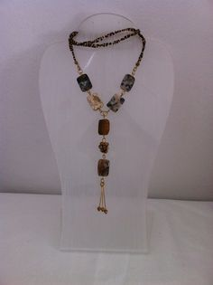 Agate slabs, jasper small rounds and gold plated chain and findings with seed beads are used to make this lovely long necklace