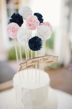 pompom wedding cake topper / http://www.himisspuff.com/pom-poms-decor-ideas-for-your-wedding/5/
