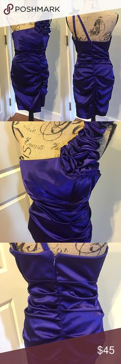 Purple One-Shoulder Dress D e s c r i p t i o n  -Gorgeous one-shoulder purple cocktail dress!  -Purchased from Dillard's + only worn once. -The dress contains a built in bra, hidden zipper in the back, and is in flawless condition! -Perfect for Homecoming, Prom, or a fancy evening out on the town!   C o n t e n t + C a r e -97% Polyester, 3% Spandex -Made in USA -Dry Clean Only  P r o d u c t // C o d e s RN#: 62335 Style#: 10387 Betsy & Adam Dresses Prom