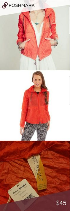Free people rain jacket Brand new, Free People rain jacket that folds up into a fanny pack! Bright red orange color will surely be a go to statement piece Free People Jackets & Coats