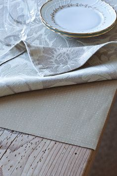 Use non-skid rug mats as table protectors- you can cut them with a pair of scissors!