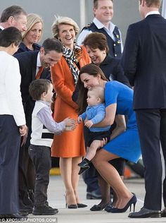 Making friends: A little boy in Canberra was very excited to meet baby Prince George, whom Kate introduced him to at Fairbairn Airport #katemiddleton #princegeorge