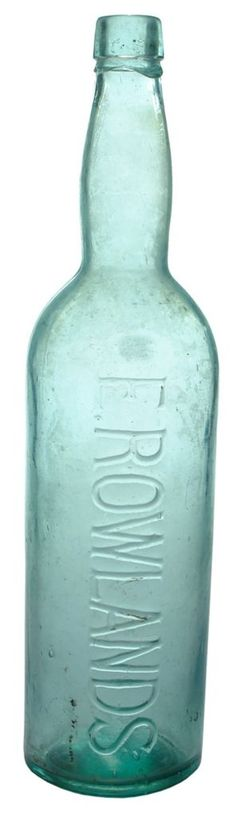 E. Rowlands. Applied top round section Cordial bottle. c1890s-1900s
