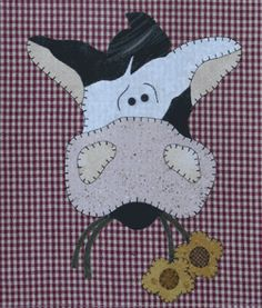 """Cow Patternlet by The Wooden Bear at KayeWood.com. Nothin' better than a daisy for breakfast!  The Wooden Bear ''Patternlets"""" are small quick appliques to use on a variety of things.  Each Patternlet shows you how to make a simple tea towel, but appliques are so versatile they shouldn't only be used as the pattern instructs. http://www.kayewood.com/Cow-Patternlet-by-The-Wooden-Bear-WB-COW.htm $4.75"""