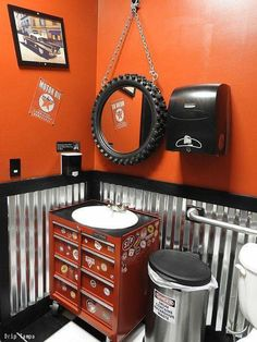 Cool garage bathroom - corrugated tin wainscoating, tire mirror, toolbox vanity, commercial paper towel dispenser