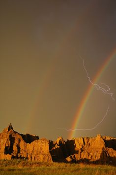 Lightning flashed through a double rainbow over the skies of 'The Badlands National Park', South Dakota By Joan Wallner, U.S. Dept. of the Interior