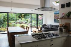 Hob on Central island overlooking garden. V sociable Kitchen Island With Drawers, Curved Kitchen Island, Kitchen Island Dimensions, Country Kitchen Island, Contemporary Kitchen Island, Kitchen Island Makeover, Kitchen Island Storage, Kitchen Island Table, Stools For Kitchen Island